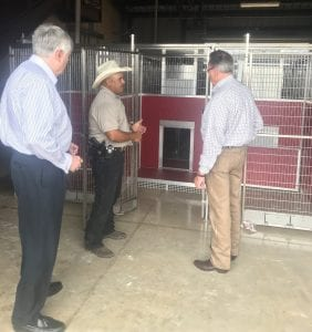 Lt. Henry Dominguez explains the kennel system to Judge Bob Hurley and Mayor Travis Hall. NOEL WILKERSON HOLMES | PLEASANTON EXPRESS