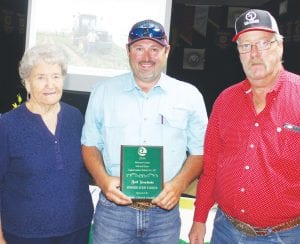 Brett Slomchinski, center, received the award as Conservation Farmer of the Year by Atascosa County SWCD #307 during their 51st Annual Banquet on Thursday, June 14. Standing with Brett is Ms. Josephine Culpepper and her son, Kenneth Culpepper, Jr., members of the Culpepper family that sponsor the award. LEON ZABAVA | PLEASANTON EXPRESS