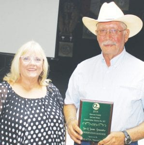 """Conservation Rancher of the Year went to Gus and Susan Gonzalez by Atascosa County SWCD #307 during their awards banquet. Gus is holding the award that was presented by SWCD Secretary/Treasurer Tina Clyburn. The award was sponsored by the late J.A. """"Jimmy"""" Palmer. LEON ZABAVA 