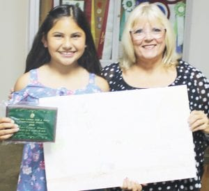 Poteet Intermediate 4th Grader, Alexandra Zavala (left) won 3rd Place in the poster contest. She is pictured with SWCD Director Tina Clyburn. LEON ZABAVA | PLEASANTON EXPRESS