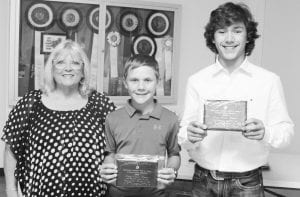 Pleasanton Junior High school winners for the Essay Contest ages 14-18 were Montgomery Cain (middle), 1st Place and Luke Raney (right), 2nd Place. They are pictured with Tina Clyburn. LEON ZABAVA | PLEASANTON EXPRESS