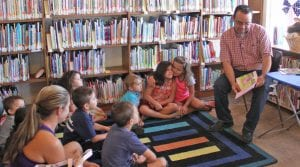 Jeff Bray reads his book during the Charlotte Public Library's story time on June 28. REBECCA PESQUEDA | PLEASANTON EXPRESS
