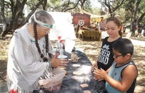 Charlotte Ramsey gives lessons in clay making to Carley Villareal and Isaiah Villareal. LISA LUNA | PLEASANTON EXPRESS