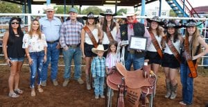 Derek Ashley, with certificate, was named the 2018 Cowboy of the Year at the Pleasanton Young Farmers' Rodeo. Left to right are Jackie Brown and Dana Briones, Pleasanton Chamber of Commerce (sponsors of the custom buckle), Darryl Ashley, 1994 Cowboy of the Year and Cowboy Selection Chair, Gus Wheeler, Atascosa Livestock Exchange and saddle sponsor. Princess Megan Huizar, Queen Aubrey Guerra, Queen Amber Guerra, Princess Bailey Lopez and Princess Bobbie Rice of the Cowboy Homecoming court assisted with the ceremony. Derek's nephew and niece Dunn and Ella Evans were excited that their uncle won. They are the children of Megan Ashley Evans and Cole Evans. Derek also received a handmade halter and rawhide slide from Roy Alonzo (2013 Cowboy of the Year) and a Cinch vest donated by Patty and Ricky Jo Lee, monogrammed by TNT Graphics. TOM FIRME | PLEASANTON EXPRESS