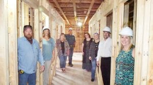 Atascosa Family Crisis Center Capital Campaign organizers are excited to tour the nine new bedrooms that are being built as part of AFCC's new shelter. Plans are for the shelter to be open by the end of the year. Pictured left to back: Mark Pawlik, Southlan Custom Homes/contractor; Sherry Gaydos, Board President; Shawnene Heather, Outreach Coordinator; Walt Rakowitz, Capital Campaign Committee member; Right to back: Jessica Tom, Capital Campaign Chair; Rusty Garvin Capital Campaign member; Jennifer Blain, Residential Services Coordinator; Rhonda Williamson, Executive Director NOEL WILKERSON HOLMES | PLEASANTON EXPRESS