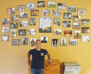 J Garcia, Pleasanton photographer and member of the Pleasanton Volunteer Fire Department with his wall of photos at the fire station. LEON ZABAVA | PLEASANTON EXPRESS