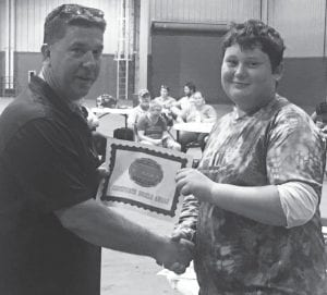 Tom Thompson, San Angelo Stock Show and Rodeo event coordinator, presents Brannan Woelfel with a certificate for his participation in the Archery Competition. COURTESY PHOTO