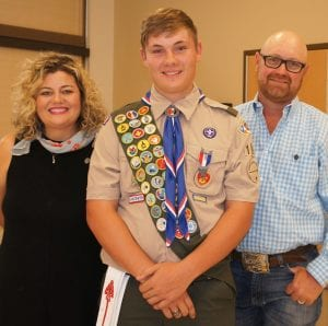 Eagle Scout Davin Ray Startz is joined by his parents, Cristal and Aaron Startz.