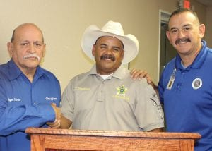 The City of Poteet has signed an interlocal agreement with Atascosa County to utilize the new Animal Control Facility. Pictured, left to right, Poteet Mayor Albert Treviño, Animal Control Facility manager, Lt. Henry Dominguez and Poteet Public Works Director Bobby Buentello at the Poteet City Council meeting on Tuesday evening. LEON ZABAVA | PLEASANTON EXPRESS