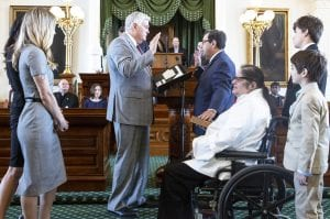 Atascosa County Judge Robert L. Hurley swears in Texas Senator Peter Flores. The senator is joined by his wife Elizabeth and family. COURTESY PHOTO