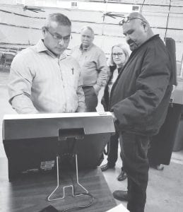 Chester Gonzales (left) makes selections while testing one of the new voting machines with Ray Briseno (right) guiding him through the process. TOM FIRME | PLEASANTON EXPRESS