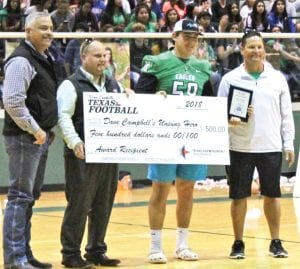 Hunter Norment receives a $500 check as one of five, 2018 Dave Campbell's Unsung Hero Award recipients.