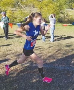 McMullen County's Caeli Taylor strides down a stretch of the 1A state cross-country meet at Old Settlers Park in Round Rock on Nov. 3. CONTRIBUTED PHOTO