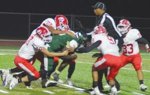 Jourdanton's Duell Arnold (40), Logan Huereca (22) and Miguel Galindo (9) gang up for a tackle during the win against Cole on Nov. 9. JOE DAVID CORDOVA | PLEASANTON EXPRESS