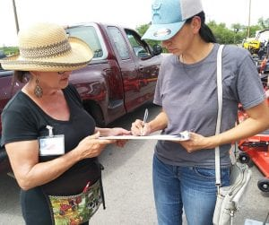 Marie Levy and petition signer at Tractor Supply in Pleasanton.