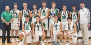Pleasanton boys basketball team members with their runner-up medals from the Hondo Owls Tournament, including, on the front row (from left), Jerry Lee Ramirez, Santiago Arguijo, Kameron Parks and Isaiya Rocha. In the back row are head coach Ricardo Marquez, Kade Loeffler, Cole Wiechring, Ralph Guerrero, Dalton Hobbs, Claven Maxwell, Johnny Zamora, Gabe Robles and assistant coach Tim Salinas. J GARCIA | PLEASANTON EXPRESS