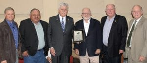 Atascosa County Auditor Ray Samson, who retired on November 30, was honored and presented with a plaque during Commissioners' Court meeting, Monday, November 26. From left, are Comm. Mark Gillespie, Pct 1; Comm. Eliseo Perez, Pct. 3; Judge Bob Hurley; County Auditor Ray Samson; Comm. Bill Carroll, Pct. 4 and Comm. Bill Torans, Pct. 2. LEON ZABAVA | PLEASANTON EXPRESS