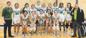 Pleasanton's girls basketball team celebrates its pool championship in the Austin St. Michael's Holiday Tournament on Dec. 29. In the front row (from left) are Messiah San Miguel, Heaven Marquez, Kalyssa Rios, Baylee Bauer and Calli Jones. In the back row are head coach Daryl Rentfro, Kasie Castillo, Brianna Garcia, Kathleen Valadez, Emily Hilburn, Eryn Wilson, Kenly Miller, Harper Brymer, Diamond Brownlee, Madelynn Garza and assistant coach Jose Guajardo. CONTRIBUTED PHOTO