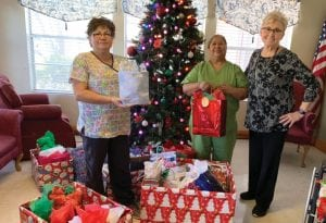 Atascosa McMullen Retired School Personnel delivered Christmas gifts to Poteet Manor. Gloria Casias, Rosita Soto and Deborah Mills, AMRSP President.