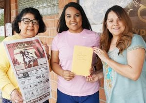 Sienna Rodriguez, center, is presented with her $500 Cowboy Crazy Cash certificate from Hope Garza, left and Amanda Velasquez with the Pleasanton Express. NOEL WILKERSON HOLMES | PLEASANTON EXPRESS