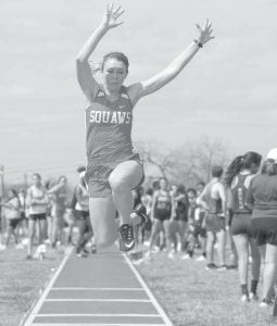 Jourdanton's Shyanne Bauerle flies through the air during her winning long jump performance. J GARCIA | PLEASANTON EXPRESS