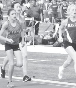 Pleasanton's Kennedy Guajardo (left) and Caitlyn Nieschwitz (behind) make a move during the 800 meter run. Guajardo finished first and Nieschwitz was second in the 800 meter run. Nieschwitz won the 1600 meter run. TOM FIRME | PLEASANTON EXPRESS