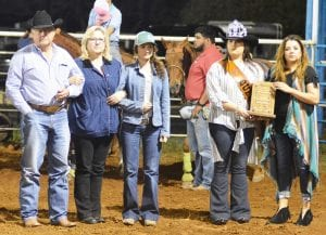 Cody's parents, Donny and Melody Lawrence along with his girlfriend Rozlyn Reeves are presented a plaque dedicating the 2019 Cowboy Homecoming Rodeo to Cody's memory by Queen Elena Ortiz and Amanda Velasquez with the Pleasanton Express. JOE DAVID CORDOVA   PLEASANTON EXPRESS