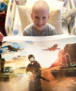 Gage and his Capes & Crown's superhero poster. He chose a man in combat for his hero.