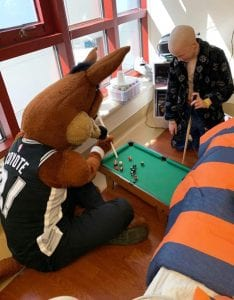 Gage and the Spur's Mascot, The Coyote playing pool at Methodist Children's Hospital.