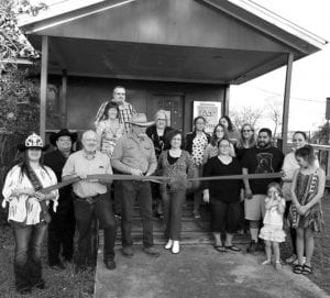 Attending the ribbon cutting for new Pleasanton Chamber of Commerce member, ACT Theatre, are (left to right) 2019 Cowboy Homecoming Queen Elena Ortiz, Ernest Gay, Kevin Patrick Dowd, Carolyn Dowd, Jeremy Ginn, Sandy Locke, Sue Brown; Lucinda Vickers, Kendra Casias, Jillian Barcomb, Jolynn Casias, Amanda Alviar, Carol Barcomb, Tony Casias, Caliope Maxwell, Jessica Maxwell, and Sirrah Maxwell. SUE BROWN | PLEASANTON EXPRESS