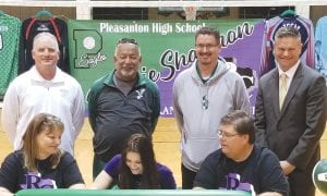 Pleasanton's Kaycie Shannon (front center) signs with Ranger College surrounded by (in front) parents Tammy and Joe Shannon and (in back) athletic director Tab Dumont, coaches Gabriel Aguirre and Brant Bird and superintendent Matthew Mann. TOM FIRME | PLEASANTON EXPRESS