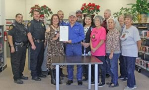 Poteet Mayor Albert E. Treviño read and signed a proclamation declaring the week of April 7-13, 2019 at National Library Week at the Poteet Public Library. Pictured, from left, are Officer Bruno Garcia, Chief Bruce Hickman, Librarian Lisa Burbridge, Public Works Director Bobby Buentello, Mayor Albert Treviño, City Administrator Eric Jiminez, Andrea Faz, Isabel Treviño, Bruce Melcher, Cleo Vargas, Janice Smith, and Ginger Olivares. REBECCA PESQUEDA| PLEASANTON EXPRESS