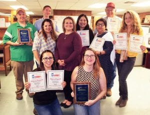 The Pleasanton Express team racked up awards at this year's STPA Better Newspaper Contest. Pictured, front row, Rebecca Pesqueda, Reporter; Rhonda Chancellor, Business Manager; middle row, Amanda Velasquez, Marketing Director; Loni Just, Ag Editor/Classifieds Manager; Lisa Luna, Lifestyles Editor; Hope Garza, Office Manager; Noel Wilkerson Holmes, Publisher/Managing Editor; back row, Aaron Davidson, Graphic Designer, Tom Firme, Sports Editor and Joe David Cordova, Photographer. ROBBIE DENSON | PLEASANTON EXPRESS