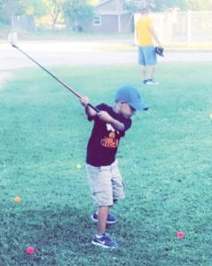 A fan of golf, Aiden Lopez swings away.