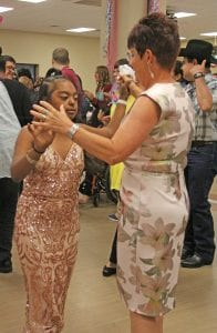 Sheri Mitzel, co-founder of Jamie's Ranch, dances with a Somerset student. PHOTOS BY REBECCA PESQUEDA | PLEASANTON EXPRESS