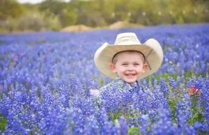 """Congratulations to Zane Youngblood, son of Jennifer and Robert Youngblood. Zane's photo is the winner of the """"People in Wildflowers"""" category of the contest. Photo taken off Schuettig Rd. in Poteet. JENNIFER YOUNGBLOOD"""