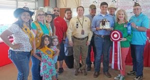 """Nathaniel Gonzales' Chocolate Covered Strawberry Blast Cake won """"Berry Best of Show"""" and sold for $1,150. Buyers were, from left: Miss Lions Rachelle Casias-Poteet Lions Club, Molly Solis-Poteet Lions Club, Miss 1st Runner Up Tahis Ramirez-Poteet Lions Club, Jay Dominguez-Silver Eagle Distributors-Bud Light, Richard Castillon-Cricket Wireless, Ron Mixon- Poteet Rotary Club, Bill Arlitt-Best 1 Hummingbird Feeders, Nathaniel Gonzales-winner, Casey Bartek-Bartek Construction, Aubrey Smith- H-E-B and John Shipley-Poteet VFW. Up front are Little Miss Lions Beulah Domsch and Little Miss Lions Miranda Solis with Poteet Lions Club. Buyers not pictured are Marissa and Travis Martinez. NOEL WILKERSON HOLMES 