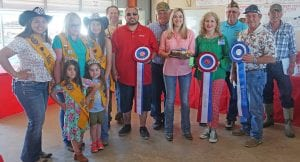 """Winning """"Best of Show"""" was Morgan Schultze with her Cheesecake Factory Carrot Cake Cheesecake that sold for $1,000. Buyers were, from left: Miss Lions Rachelle Casias-Poteet Lions Club, Molly Solis-Poteet Lions Club, Miss 1st Runner Up Tahis Ramirez-Poteet Lions Club, Ron Mixon- Poteet Rotary Club, Jay Dominguez-Silver Eagle Distributors-Bud Light, Bill Arlitt-Best 1 Hummingbird Feeders, Morgan Schultze-winner, Aubrey Smith-H-E-B, John Shipley-Poteet VFW, Mark Biediger-Pure Party Ice, and Vance Schultze-Tank Hollow Fisheries. Up front are Little Miss Lions Beulah Domsch and Little Miss Lions Miranda Solis with Poteet Lions Club. NOEL WILKERSON HOLMES 
