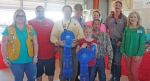 """""""Best of Show Jelly"""" winner was Hailey Hannah with her Strawberry Jam that sold for $800. Buyers were, from left, Molly Solis-Poteet Lions Club, Jay Dominguez-Silver Eagle Distributors-Bud Light, Ron Mixon-Poteet Rotary Club, Bill Arlitt-Best 1 Hummingbird Feeders, Alice Denson- Data Network Cabling, Clint Spaeth-Hang 'Em High Cookers, Walt Rakowitz- Rakowitz Engineering and Aubrey Smith-H-E-B. Up front is winner Hailey Hannah. NOEL WILKERSON HOLMES 