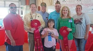 """Analise Cruz won """"Best of Show Salsa"""" with her Strawberry Corn Salsa that sold for $800. Buyers were, from left, Jay Dominguez-Silver Eagle Distributors-Bud Light, Ron Mixon-Poteet Rotary Club, Bill Arlitt-Best 1 Hummingbird Feeders, John Shipley-Poteet VFW, Aubrey Smith-H-E-B and Megan Sparks-Methodist Hospital South. Up front is winner Analise Cruz. NOEL WILKERSON HOLMES 
