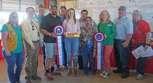 Elizabeth Winder won Reserve Grand Champion Adult Divisionwith her Strawberry Lasagna. It sold for $1,000 to buyers, from left, Molly Solis- Poteet Lions Club, Ron Mixon-Poteet Rotary Club, John Shipley-Poteet VFW, Gabe Medina-Potable Shelter Store, Pat West, Elizabeth Winderwinner, Richard Castillon-Cricket Wireless, Clint Spaeth- Hang 'Em High Cookers, Aubrey Smith-H-E-B, Larry Wagner-Matco Tools and Melanie Eichman-Bruce C Eichman Photography. NOEL WILKERSON HOLMES | PLEASANTON EXPRESS