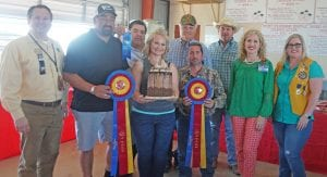Leigh Ann Gonzales won Grand Champion in the Adult Division with her Tall, Dark and Handsome Cake that sold for $$975 to buyers, from left, Ron Mixon-Poteet Rotary Club, Gabe Medina-Portable Shelter Store, Richard Castillon-Cricket Wireless, Leigh Ann Gonzales-winner, Bill Arlitt-Best 1 Hummingbird Feeders, Clint Spaeth-Hang 'Em High Cookers, Casey Bartek- Bartek Construction, Aubrey Smith-H-E-B and Molly Solis-Poteet Lions Club. NOEL WILKERSON HOLMES | PLEASANTON EXPRESS