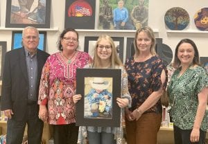 "Gilbert LaFuente with Congressman Henry Cuellar's office congratulates PHS student Leslie Hartman as the winner of the Texas 28th District Congressional Art Show. She submitted her prismacolor drawing titled ""Next Generation."" She won a trip to Washington, DC and her artwork will be framed and hung in the Cannon tunnel to the Capitol Building for one year. Pictured left to right are: Gilbert LaFuente, Sharon Kotzur, Leslie Hartman, mother Jan Hartman and Principal Guajardo. NOEL WILKERSON HOLMES 