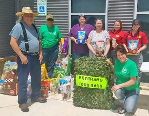 These groups joined together to help local veterans and their pets. Pictured left to right: Joseph Ponce, US Veterans Council; Suzy Pena, US Veterans Council; Vicki Eckert, Atascosa Spay/Neuter Assistance Program; Linda Carter, Atascosa Spay/Neuter Assistance Program; Sabrina Steinbeke, Atascosa County Animal Control Facility; Melissa Henry, Atascosa County Animal Control Facility and kneeling, Stephanie Pino, Atascosa County Veterans Food Bank/ US Veterans Council. CONTRIBUTED PHOTO
