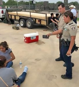 Deputy Valdez and Deputy Kaufman tend to two of the females who were suffering from severe dehydration. CONTRIBUTED PHOTO