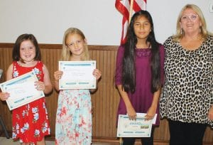 Conservation Poster winners are, from left, Riley Hilburn, 3rd place; Adelyn Katsmorak, 2nd place; Grace Gonzales, 1st place. Tina Clyburn presented the awards. LEON ZABAVA | PLEASANTON EXPRESS