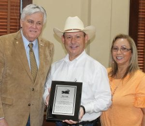 Atascosa County Judge Bob Hurley presenting Rick Luna with a plaque for his 29 years of service as a Constable, Precinct 3. His wife Amanda is at his side during the presentation at the courthouse, Tuesday, June 25. LEON ZABAVA | PLEASANTON EXPRESS