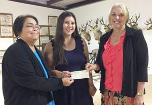 Longhorn Museum vice-president Gloria Jenks, left, presents a $500 college scholarship to Krystal Michelle Jasik who is accompanied by Anna Jasik. Krystal, a graduate of St. Gerard Catholic High School in San Antonio, plans to attend Galveston Community College and major in Marine Biology. She is the daughter of Lisa Jasik and the late Marvin Jasik.