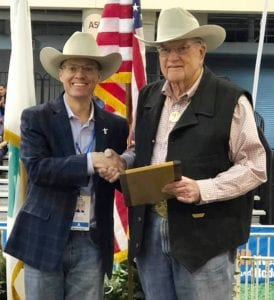 Chris Boleman, Houston Livestock Show and Rodeo Executive Director of Agriculture Exhibits and Competitions congratulates Superintendent Lifetime Achievement Award winner Tom Heffernan. HOUSTON RODEO COURTESY PHOTO