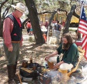 Eric Morrell of the Atascosa County Historical Commission, at right, is pictured at the 2018 Yesteryear Festival, teaching others about life on the Texas frontier. Morrell also participates in historical re-enactment events like the Battle of Medina. LISA LUNA | PLEASNATON EXPRESS FILE PHOTO